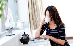 Enjoying her coffee Royalty Free Stock Photography