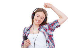Enjoying her favorite music. Stock Photos