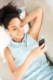 Enjoying her favorite music. Royalty Free Stock Images