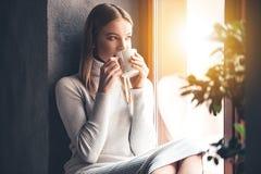 Enjoying her fresh coffee. Royalty Free Stock Images