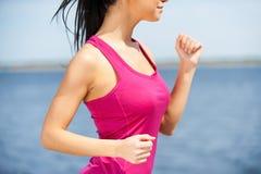 Enjoying her daily jog. Royalty Free Stock Photos