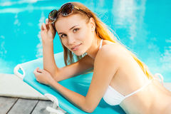 Enjoying her leisure time by the pool. Stock Image