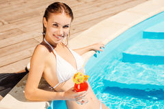 Enjoying her leisure time at the pool. Stock Photo