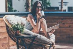 Enjoying her morning coffee. Royalty Free Stock Photography