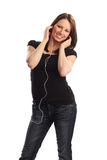 Enjoying her music Stock Image