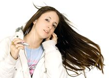 Enjoying her music Stock Photography