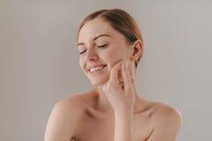 Enjoying her soft skin. Stock Images