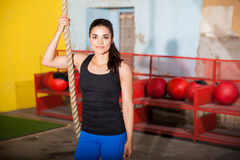 Enjoying her training in a gym Royalty Free Stock Image