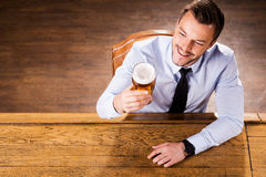 Enjoying his favorite beer. Royalty Free Stock Photography