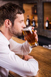 Enjoying his favorite lager. Royalty Free Stock Images