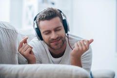 Enjoying his favorite music. Stock Photos