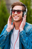 Enjoying his favorite music. Royalty Free Stock Photo