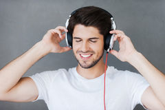 Enjoying his favorite music. Stock Images
