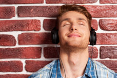 Enjoying his favorite music. Stock Image