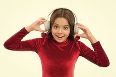 Enjoying his favorite music. happy childrens day. kid fashion and beauty. childhood and happiness. small girl in red. Dress. small child in headphones. music royalty free stock photos