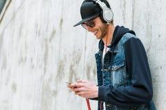 Enjoying his favorite music. Stock Photography
