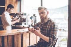 Enjoying his fresh coffee. stock images