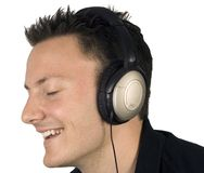 Enjoying his headphones. A man is having a good time listening to music stock image