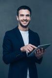 Enjoying his new digital tablet. Stock Photo