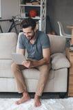 Enjoying his new digital tablet. Stock Image