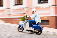Enjoying his scooter ride. Stock Image