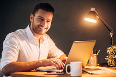 Enjoying his work even at night. Royalty Free Stock Images