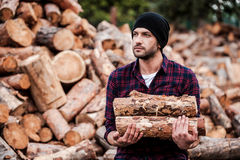 Enjoying his work with wood. Stock Images