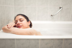 Enjoying home spa relaxation after hard day.Young woman takes bubble bath.True bliss.Total relaxation Stock Images