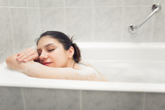 Enjoying home spa relaxation after hard day.Young woman takes bubble bath.True bliss.Total relaxation Royalty Free Stock Photography