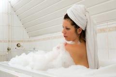 Enjoying a hot bath Stock Images