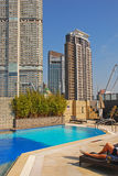 Enjoying Hotel Rooftop Swimming Pool Stock Images