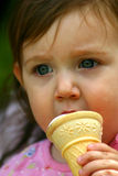 Enjoying An Ice Cream Cone. Toddler enjoying an ice cream cone Royalty Free Stock Images