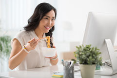 Enjoying instant noodle Royalty Free Stock Photos