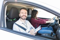 Enjoying Job Of Car Instructor stock photos