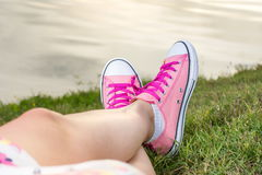 Enjoying by lake. Woman wearing pink sneakers Royalty Free Stock Images