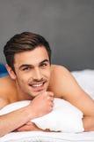 Enjoying leisure time in bed. Royalty Free Stock Photos