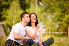 Enjoying life - couple blowing dandelions Royalty Free Stock Photos