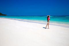 Enjoying life. Healthy woman walking on exotic sea. Fit brunette Stock Photography