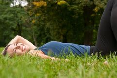Enjoying life - woman lying Royalty Free Stock Image