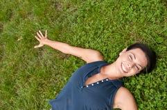 Enjoying life - woman lying Stock Photo