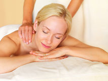 Enjoying massage at spa Stock Image