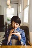 Enjoying matcha Stock Photography
