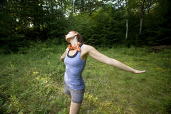 Enjoying the meadow. Twenty year old woman revels in the beauty of a meadow in the woods stock photos