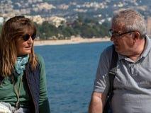 Enjoying the Mediterranean Sea between a couple royalty free stock image