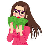 Enjoying Money Businesswoman. Young brunette businesswoman really happy enjoying and holding big fan of green money with both hands Stock Photos