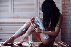 Enjoying morning routine. sexy naked woman put shaving foam cream on legs. body hygiene. self care. Feeling fresh after. Shaving. Half shaved. bare body of stock photos