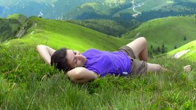 Enjoying the Mountains. Beautiful young woman relaxing and enjoying the mountains in a summer day stock footage