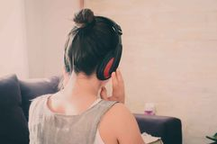Enjoying music. Girl listening to music and relaxing Royalty Free Stock Photo