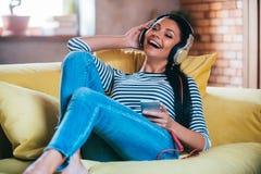 Enjoying music at home. Royalty Free Stock Photo
