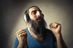 Enjoying music. Portrait of man enjoying music with headphones stock photo